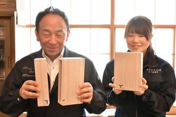 グランプリ受賞の喜びを語る吉田長芳社長(左)と五十嵐舞子さん=山形市・よしだ
