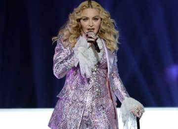 Madonna performs a tribute to Prince onstage during the Billboard Music Awards at T-Mobile Arena