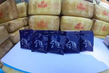 """Four million methamphetamine pills seized on the bank of the Mekong River in Tha Uthen district of Nakhon Phanom on Sunday night, with the infamous """"999"""" stamp, are displayed during a media briefing on Monday. (Photo by Pattanapong Sripiachai)"""