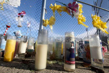 Prayer candles stand at the tribute to Dulce Maria Alavez in Bridgeton City Park, Thursday, Jan. 16, 2020. (Al Amrhein | For NJ Advance Media/)