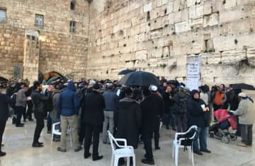 Dozens gathered at the Western Wall on February 16, 2020 to pray for those affected by the coronavirus outbreak. (photo credit: ROSSELLA TERCATIN)