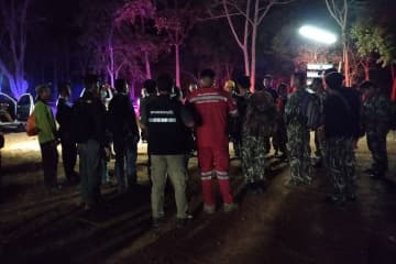 Park rangers and rescue workers gather at the Pang Sida National Park to look for a man wounded by a guar in Sa Kaeo province at dawn on Tuesday. (Photo by Apitsada Phai, Rescue Team of Sa Kaeo Provincial Administrative Organisation)