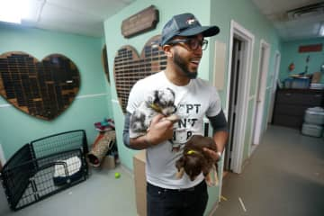 Elijah Brice-Middleton, director of the Plainfield Area Humane Society, holds two of the 36 dogs (and six cats) taken from a home in Scotch Plains. (Ed Murray | NJ Advance Media for       /)