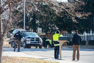 A crossing guard was struck and killed by a car Tuesday morning in the 5400 block of Leavenworth Road, while trying to stop traffic for children going to Christ the King Parish school. - Shelly Yang/Kansas City Star/TNS