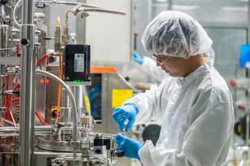A worker at the bacteria fermentation facility of Siam Bioscience in Nonthaburi.