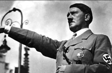 German Fuhrer Adolph Hitler doing a Nazi salute (photo credit: Wikimedia Commons)