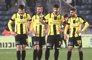 HAPOEL TEL AVIV celebrates after it earned a 1-0 victory in the capital on Monday night, while Beitar Jerusalem players (inset) wonder what went wrong. (photo credit: DANY MAROM)