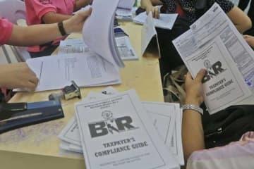 New levies, amnesty push tax effort to 22-year peak