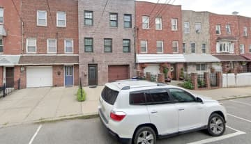 An SUV parked in front of a driveway on a Bayonne street. (Google Maps image) (EJA/)