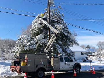 In a photo provided by JCP&L;, utility crews work to restore power in New Jersey after a major snowstorm hit the state this week. (JCP&L;/)