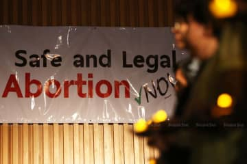 A poster is seen in Bangkok during a campaign for the right to safe abortions in 2016. (Bangkok Post file photo)