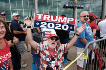 Trump supporters gather outside of an arena in Manchester before a  rally. (Photo by Spencer Platt/Getty Images) (Spencer Platt/)