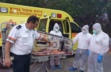 Magen David Adom paramedics are seen wearing special protective suits and preparing to evacuate Israelis returing from the 'Diamond Princess' crusie ship. (photo credit: MDA)