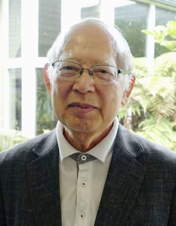 21日、ニュージーランド・クライストチャーチで、被災地を訪れた鈴木喜久男さん(共同)