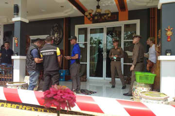Police at the house in Muang district of Phitsanulok where five members of the one family were found dead in a bedroom on Friday. (Photo by Chinnawat Singha)