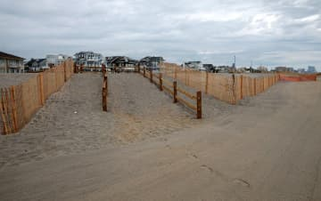 A beach entrance is under construction over new dunes in Margate, Monday, Aug. 7, 2017. (Tim Hawk/)