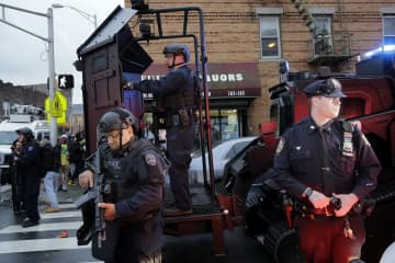 Police on the street responding to the December attack on a Jersey City kosher market in December. (Seth Wenig/)