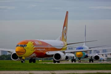 A Nok Air Boeing 737 takes off from Don Mueang airport. The airline has revised its business plan this year, including a rejig of flight schedules.