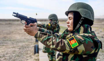 In this photo taken on February 17, 2020, Afghan National Army (ANA) soldiers take part in a military exercise at a base in Guzara district in Herat province.