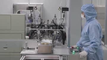 中国企業が生産体制を整え、ウイルス対策を支援