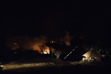 Flames spread towards a checkpoint in Thap Lan National Park in Na Di district of Prachin Buri on Saturday night. (Thap Lan National Park photo)