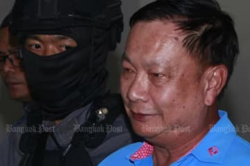 Police take former Nakhon Sawan MP Banyin Tangpakorn to the Crime Suppression Division for interrogation on Sunday. (Photo by Nutthawat Wicheanbut)