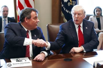 President Donald Trump shakes hands with then-Gov. Chris Christie during an opioid and drug abuse listening session in the Cabinet Room of the White House on March 29, 2017.