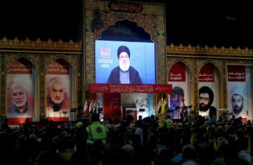 Lebanon's Hezbollah leader Sayyed Hassan Nasrallah addresses his supporters through a screen during a rally commemorating the annual Hezbollah's slain leaders in Beirut's southern suburbs, Lebanon February 16, 2020. (photo credit: AZIZ TAHER/REUTERS)