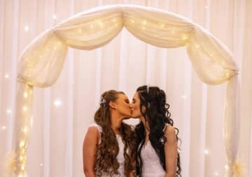 The first same-sex couple to marry in Northern Ireland following the country's legal changes.