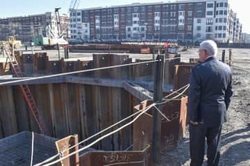 U.S. Sen. Bob Menendez looks at the construction site of the Northwest Resiliency Park in Hoboken. Menendez and Hoboken Mayor Ravin Bhalla announced the city is receiving $14 million in federal grants for flood prevention measures. (EJA/)