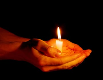 Light your candle, and step forward. - Dreamstime/Tri-City Herald/TNS