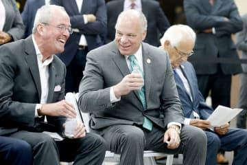 Gov. Phil Murphy (left) laughs with state Senate President Stephen Sweeney (center) in Secaucus last year. (Aristide Economopoulos   NJ Adva                    /)