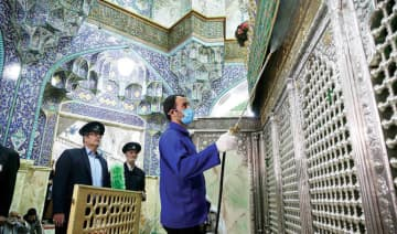 Workers disinfect Qom's Masumeh shrine, which is visited by a large number of people, to prevent the spread of the coronavirus.