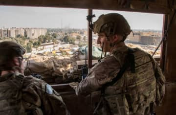 US Army soldiers keep watch on the US embassy compound in Baghdad, Iraq January 1, 2020 (photo credit: DOD/LT. COL. ADRIAN WEALE/HANDOUT VIA REUTERS)