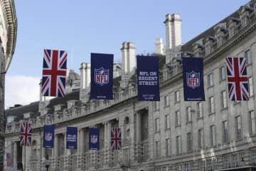 NFLロゴとイギリス国旗【AP Photo/Tim Ireland】