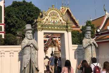 Tourists visit Wat Po on March 5, 2018. (Photo by Dave Kendall)