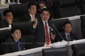 "Future Forward MP Wiroj Lakkhanaadisorn questions Prime Minister Prayut Chan-o-cha about the budget earmarked for the military to launch ""cyber wars"" against people, during the censure debate on Tuesday night. (Photo by Wichan Charoenkiatpakul)"