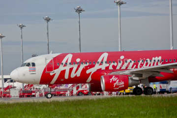 An A320 aircraft of AirAsia is seen at Don Mueang airport, the hub of the airline. (Photo by Krit Phromsakla Na Sakolnakorn)