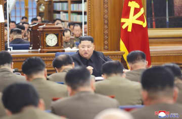 NORTH KOREAN LEADER Kim Jong Un addresses the Third Enlarged Meeting of the Seventh Central Military Commission of the Workers' Party. (photo credit: REUTERS/KCNA)