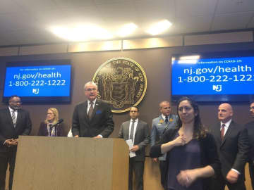 Gov. Phil Murphy (center) holds a news conference on how New Jersey is responding to the coronavirus at the State Police command center in West Trenton on Monday. (Brent Johnson/)