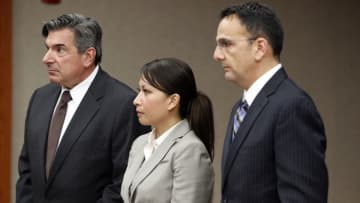 Middlesex County Superior Court Judge Carlia Brady has sued the Woodbridge Police Department alleging malicious prosecution. Brady (center) is shown in a 2013 court hearing with her attorneys. (Murray, Ed/)