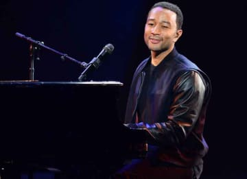 LAS VEGAS, NV - JANUARY 07: Recording artist John Legend performs during a keynote address by Yahoo! President and CEO Marissa Mayer at the 2014 International CES at The Las Vegas Hotel & Casino on January 7, 2014 in Las Vegas, Nevada. CES, the...