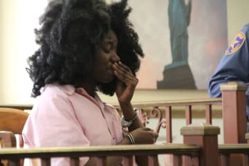 Malika Jones, 22, wipes away tears as she sits in Superior Court of Union County on March 4, 2020. (Rebecca Panico/)