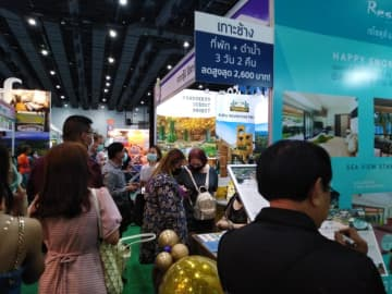 Visitors check out deals at the Thai Teaw Thai travel fair. Operators are concerned about diminishing returns from cash giveaways.Dusida Worrachaddejchai