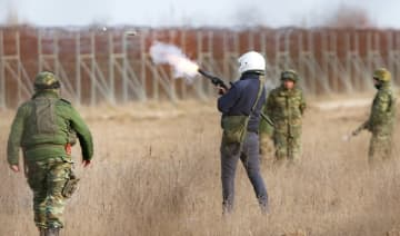 Greek military fire teargas canisters during clashes between migrants and Greek police and army personnel near the Kastanies border gate at the Greek-Turkish border, Sunday, March 1, 2020.