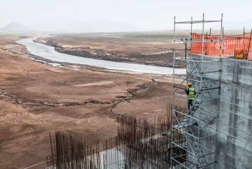 Construction at the Grand Ethiopian Renaissance Dam, near Guba — a 145-metre-high, 1.8-kilometer-long concrete colossus set to become the largest hydropower plant in Africa.