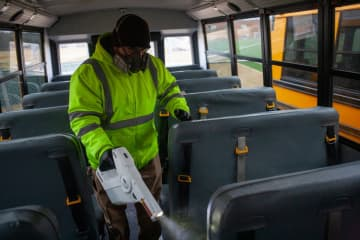 Custodian Andrew Knight sprays disinfectant on the seats of a school bus at Mount Olive Middle School in Budd Lake on Friday, March 6, 2020. Dustin Niles | For NJ Advance Me (Dustin Niles | For NJ Advance Media/)