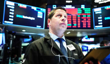 A trader working on the floor of the New York Stock Exchange (NYSE) in New York, U.S., March 9, 2020.