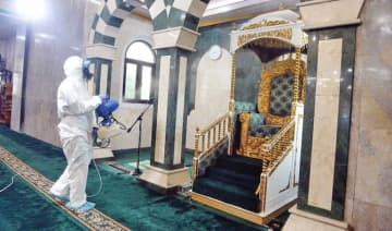 A sanitation team disinfects Al-Munawwarah Mosque in Jakarta.