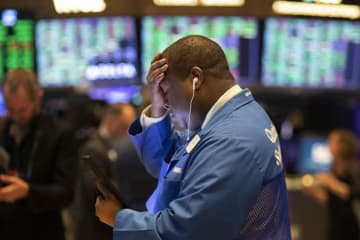 Stock trader Thomas Lee works at the New York Stock Exchange, Friday, March 13, 2020. Stocks are opening sharply higher on Wall Street a day after the worst drop since 1987. (AP Photo/Mark Lennihan) (Mark Lennihan/)